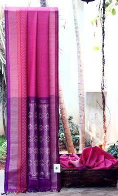 LUSTROUS PINK IS UPLIFTED BY PURPLE AND SILVER BORDER. THE PURPLE PALLU WITH SILVER GIVES THE SAREE SMOOTH FINISH.