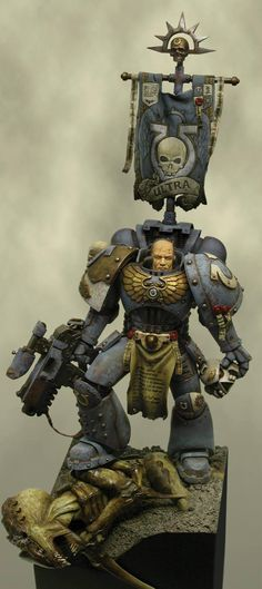 Warhammer 40k Space Marines. The single best paint job I have ever seen. Ultramarines Sergeant
