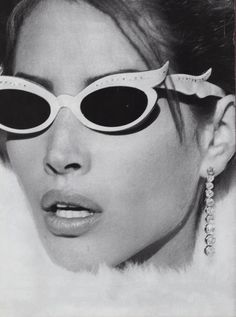 1989. US Vogue. Model Christy Turlington cateye sunglasses. Photo by Steven Meisel (B1954)