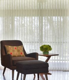 Meet both decorating and practical needs with the ethereal luxury and translucent light filtering and control of Luminette® Privacy Sheers ♦ Hunter Douglas window treatments #LivingRoom
