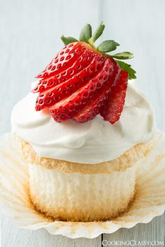 Angel Food Cupcakes - with a cream cheese whipped cream topping and fresh berries. These are amazing! Best angel food cake I've had.
