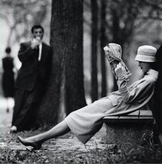 I love this lovely black and white photo of a woman taking a break in the park... Who is her admirer, and what does he want?!