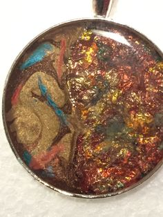 Bezel filled with gilding flakes & pebeo fantasy moon & fantasy prisme then filled with resin