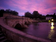 Ross Bridge in Tasmania is cloaked in a mauve sunset. The beautiful sandstone span, built by convicts in 1836, is one of Australia's oldest and is decorated with an impressive array of carvings. (http://photography.nationalgeographic.com/photography/photos/life-color-purple)