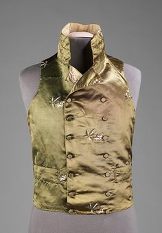 1800-1810 Waistcoat - Vest. British of Silk, linen and metal. This very elegant vest is indicative of the taste for very high stand collars alongside double-breasted waist-length styles which came into focus near the end of the 18th century.  See and read more about it at http://www.metmuseum.org/Collections/search-the-collections/80095566?rpp=60=4=waistcoat=214#