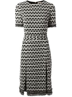 Tory Burch Perforated Stripe Knit dress, also called the Paulina dress at most retailers.
