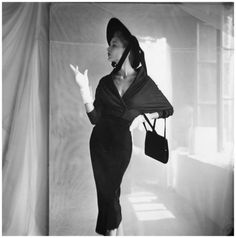 modeling wrap shirt and straight long skirt by Ruth Fair, wide-brimmed hat, and black bag by Alan Oct 1949 - Photo Frances McLaughlin-Gill