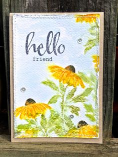 Penny Black Petal Power daisy was stamped multiple times using distress inks. The water-colour paper was mounted on a kraft card base, and the Winnie & Walter greeting was stamped in the top left corner with some added sequins finishing the look.