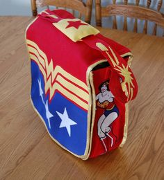 Wonder woman Costume inspired messenger bag by Liliatodd, via Flickr using thick almost canvas material and modge podge peices yo decorate front (w's and stars) could use laminated drawing for decor costume wonder woman?