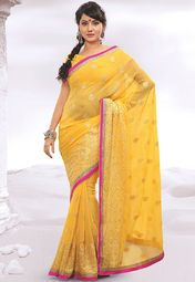Perfect for special occasions, this yellow coloured saree from Hypnotex will certainly make you stand out in the crowd for your elegant taste. Featuring beautiful pink patch patti border and fine embroidery, this saree looks appealing. Made from chiffon, this 5.5 m saree is light in weight and fine in quality.