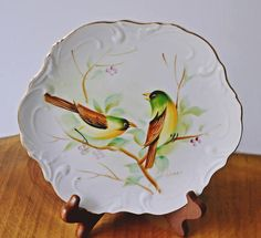 Check out this item in my Etsy shop https://www.etsy.com/ca/listing/514073798/hand-painted-bird-plate-collector-plate