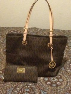 2b342cac4d44 Michael Kors brown w  tan purse and wallet.