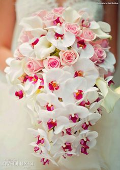 I really like the idea of the mix of roses and orchids, cascading to add floral drama.