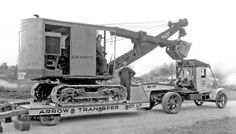 """International Heavy Hauling in Vancouver, B.C.: On their current website, Arrow Transportation claims that, """"from whales to wood chips, we have hauled virtually every type of product."""" In this photo they are moving a very interesting heavy shovel with an International tractor which you can learn more about @ http://theoldmotor.com/?p=108039"""