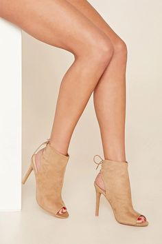 An faux suede open-toe bootie featuring a lace-up back and a stiletto heel.