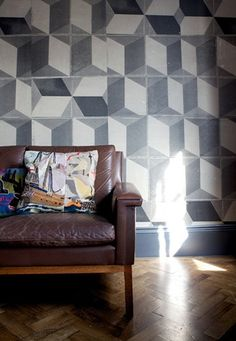 Cool geometric wallpaper with funky pillows and distressed leather couch :-D Leeds College Of Art, Standard Wallpaper, Room Of One's Own, Tile Wallpaper, Geometric Tiles, Handmade Tiles, Designer Wallpaper, Interior Inspiration, Contemporary