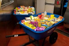 Candy Served in Wheel Barrows at NY Bat Mitzvah - {Party Planner: The Event of a Lifetime, Ellen Dubin Photography} - mazelmoments.com