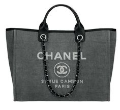 Presenting the Chanel Deauville Tote Bag. This tote bag first originated from Chanel's Spring/Su...