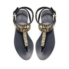 metallic and black sandals