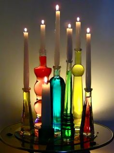 clear candle holders filled with colored water, great for parties, weddings, and home decor