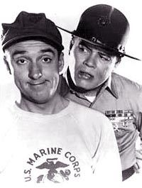 Gomer Pyle, USMC (1964–1969) - Cast and history: http://www.imdb.com/title/tt0057752/  Theme music:  http://www.youtube.com/watch?v=_JAA2Unb0B4