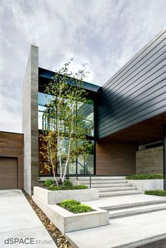 Modern entry, large windows, concrete steps