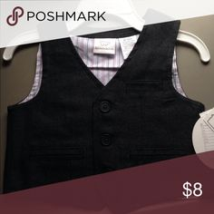 Adorable button up vest. Multiple sizes! Perfect way to dress up any outfit for any occasion. Gray button up vest with two fake front pockets and a handkerchief pocket. Red and black striped lining. Multiple sizes available. Koala Kids Jackets & Coats Vests
