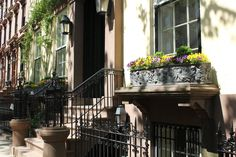 Custom built window boxes adorn parlor floor windows at 70 Willow Street, Brooklyn Heights, former home of writer Truman Capote between 1955 and 1965.