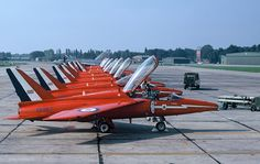 Red Arrows, Gnat In the background is a series of Lightning of RAF Gütersloh September 1972 Air Fighter, Fighter Jets, Folland Gnat, Raf Red Arrows, The Spitfires, Royal Air Force, Jet Plane, Fighter Aircraft, Air Show