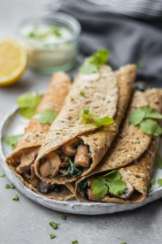 Weekend breakfast doesn't get much better than vegan buckwheat crepes with creamy mushrooms! Also great as breakfast for dinner. #veganrecipes #savourybreakfast #vegancrepes #easyveganrecipes #glutenfreevegan