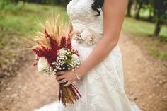 Wheat bouquet with baby's breath -- maybe replace the red with fake cranberries and add some orange elements?