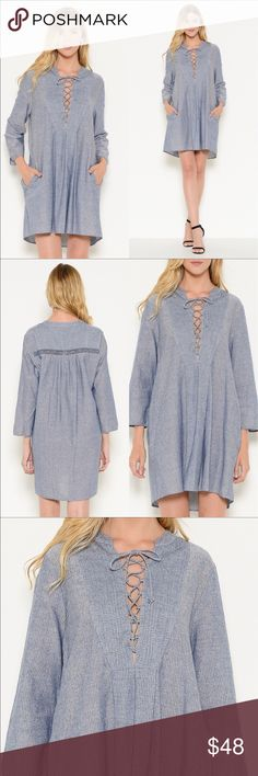 🆕Lace Up Woven Dress From Esley Collection Simple elegance this tunic has a tie up front and two pockets. Extremely attractive . 100% cotton. Esley Dresses Mini