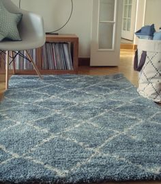 Nomad Rug in blue, beige, and pink.  Perfect for children's bedrooms, playrooms, and schools.  Woven from a synthetic wool for a strong and robust finish, so even with intensive use the rug surface will maintain its design and colours. Easy to clean, water resistant, anti-static, anti-bacterial, anti-dust mite and helpful for noise reduction.