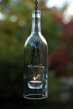 Old wine bottles recycled into hurricane or hanging lanterns for candles. Great idea, and surprisingly easy to do.