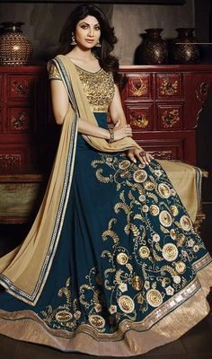 Weave your way into any party as Shilpa Shetty with this blue color embroidered georgette floor length Anarkali suit. The stunning lace, stones and resham work bestows the attire with a perfect allurement. #floralembroideredanarkalidress #flaredanarkalis #georgetteemboideredanarkalidresses