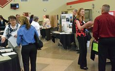 Employers and job seekers talk during a Reverse Job Fair held Tuesday in the commons area of Vantage Career Center. (Dave Mosier/Van Wert independent)