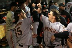 Ryan Theriot celebrates scoring the go-ahead run in the 10th (Game 4)
