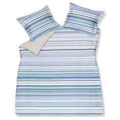 Bedding in striped shades of white and blue.