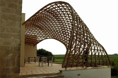 The parametrically designed patio cover for the Masseria Ospitale Restaurant in Lecce, Italy is a design by Gridshell involving architects, students, and professors from University of Naples