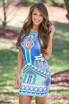 If you want to look like a prize, you NEED this dress! The unique print, vibrant colors, and fitted style will have you looking and feeling your absolute best! It is made of a sleek material and has a zipper in the back!
