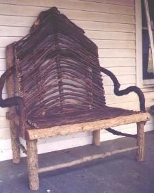 grapevine prunings make the back of this rustic bench