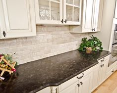 Kitchen Design, Enchanting Traditional Kitchen Cabinets And Table With Antique Brown Granite Countertop And Antique White Bricks Backsplash Also Green Plant And Blonde Laminate Floor Color: Wonderful Alaskan White Granite