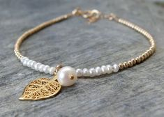 Gold pearl bracelet Gold leaf bracelet Maid of honor pearl bracelet Bridal bracelet Bridal jewelry Wedding jewelry Dainty leaf bracelet by AngelicSpark on Etsy #bridaljewelrygold