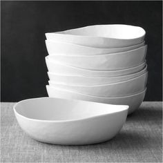 """Sale ends soon. Shop Mercer Grey Low Bowls, Set of Our contemporary porcelain dinnerware sets a table of refinement and rusticity. The low pasta bowls take on organic overtones with freeform rims and a finely """"hammered"""" surface that ripples the light. Porcelain Dinnerware, Dinnerware Sets, Dinner Plate Sets, Dinner Plates, Dinner Sets, Crate And Barrel Sectional, Kitchen Dishes, Kitchen Stuff, Kitchen Ideas"""
