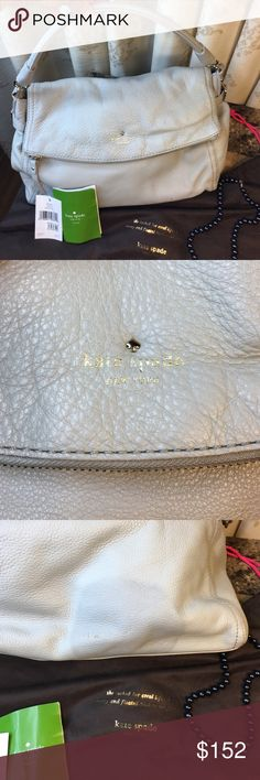 """Kate Spade leather Little Minka 💕 Kate spade Little Minca handbag. There is a circular stain on back of bag, see pic. A timeless Kate Spade New York handbag in soft pebbled leather. A spacious zip compartment details the front flap, which fastens the top with a magnetic closure. The striped lined interior has three pockets.  Metal feet. Silver tone hardware. Dust bag included 10 """" high 13 """" wide. As is, ink marks inside, couple small ink spots on front, leather is in great condition. No…"""