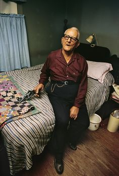 """Untitled, c.1969–70 by William Eggleston """"Charlie Boynkin, sheriff of Morton, Mississippi, would act as Eggleston's bodyguard while he did night shoots in the town. Here we see him in his own bedroom."""""""