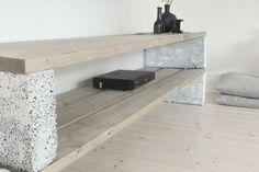 Cinder Blocks Shelf with Black Jars Pillows Wood Floors White Walls