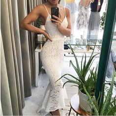 Suzy Dress. A beautiful lace dress by Elle Zeitoune. A v-neck style featuring a frill hemline. https://bellanblue.com