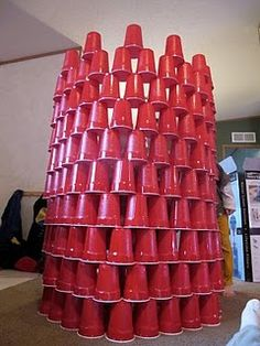 Cup Stacking + 9 other ideas - Activities For Boys.  Who doesn't like building something just to smash it!!!