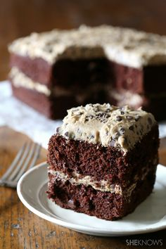 Indulge in your cookie dough obsession by frosting a chocolate cake with it
